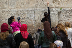 Women near Western Wall pray and leave their notes Royalty Free Stock Photo