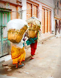 Women in Nepal Carrying Baskets Royalty Free Stock Images