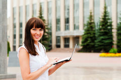 Women with netbook. Business woman happy with her work Royalty Free Stock Photos