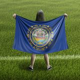 Women and New Hampshire flag royalty free stock images