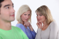 Women observing a man Stock Photos
