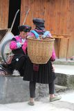 Women Of The Red Yao Hilltribes In Traditional Costume With Wicker Basket, Longsheng, China Royalty Free Stock Photos