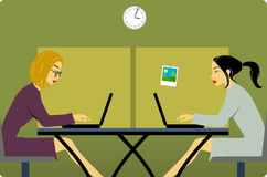 Women in the office. Two women in the office with laptops Royalty Free Stock Photos