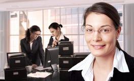 Women in office. Women work in brightly lit office. Daylight, indoor, office Stock Photos