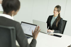 Women at the office stock images