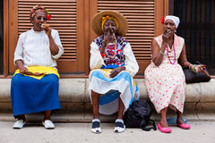Women in Old Havana smoking cuban cigars Stock Images