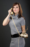 Women with old phone Royalty Free Stock Images