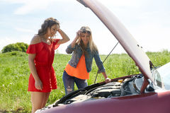 Women with open hood of broken car at countryside Stock Image