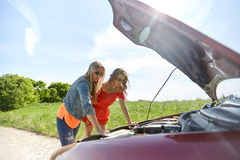 Women with open hood of broken car at countryside Royalty Free Stock Image