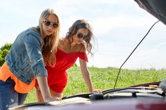 Women with open hood of broken car at countryside Stock Photo