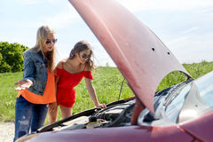 Women with open hood of broken car at countryside Stock Photography