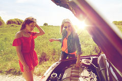 Women with open hood of broken car at countryside Stock Images