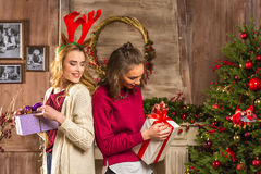 Women opening christmas presents royalty free stock photos