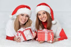 Women opening Christmas presents Stock Image