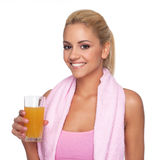Women with orange juice Stock Images