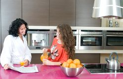 Women with orange juice at kitchen Royalty Free Stock Photo