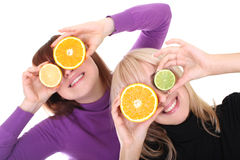 Women with orange and lime slices instead of eyes Royalty Free Stock Images