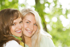 Women outdoors. Two beautiful young women outdoors Royalty Free Stock Photography