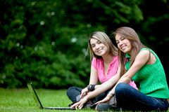 Women outdoors with computer Royalty Free Stock Photography
