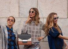 Women outside Marco De Vincenzo fashion shows building for Milan Women's Fashion Week 2014 Royalty Free Stock Image