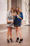 Women outside Marco De Vincenzo fashion shows building for Milan Women's Fashion Week 2014 Stock Images