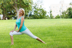 Women outside. Women practising yoga in the meadow Stock Photos
