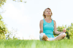 Women outside. Women practising yoga in the meadow Royalty Free Stock Photo