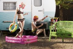 Women outside a trailer Stock Images