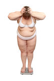 Women with overweight on scales Stock Images