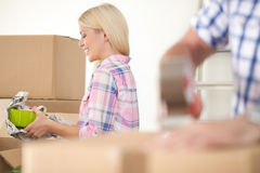 Women packing. Some household things in moving boxes Stock Image