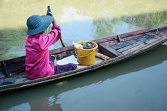 Women paddle boat on canal , Thailand Life Royalty Free Stock Photo