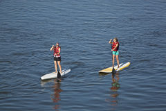 Women paddleboarding Royalty Free Stock Image