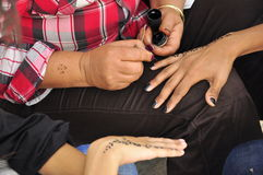 Women painting hands with henna Stock Photography
