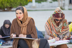 Women painting in Naqsh-e Jahan Square in Isfahan, Iran. stock images