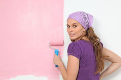 Women painting nursery wall. Young woman painting nursery wall pink Stock Photos