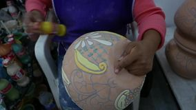 Delores Hidalgo, Mexico-January 10, 2017: Women painting pottery stock video