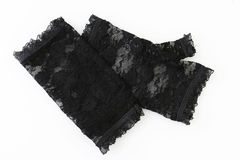 Women pair of black lace gloves on a white. Background Stock Photos