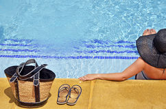 Women with pamela in a relaxed position in the pool Stock Images