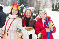 Women with pancake during  Shrovetide Royalty Free Stock Photo
