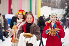 Women  with pancake during  Shrovetide Stock Photography