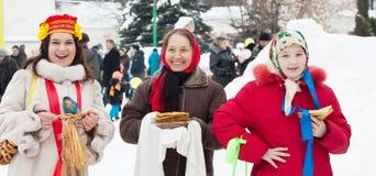 Women with pancake during  Shrovetide Stock Image