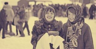 Women with pancake during Shrovetide stock photo