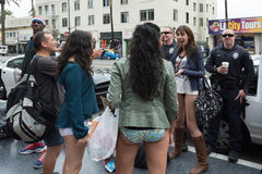 Women without pants and police in Hollywood in the Royalty Free Stock Photo