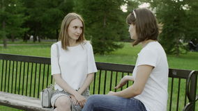 Women on the park bench stock video footage