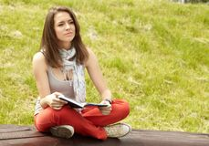 Women in the park with book stock photography