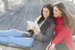 Women in the park with tablet Royalty Free Stock Photo