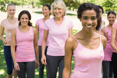 Women participating in breast cancer awareness at park Stock Photography