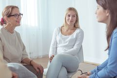 Women participating in group therapy. Young  beauty women participating in group therapy Stock Images