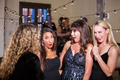 Women at Party React to Gossip or Dirty Joke Stock Images