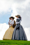 Women from the past, against a cloudy sky Stock Photos
